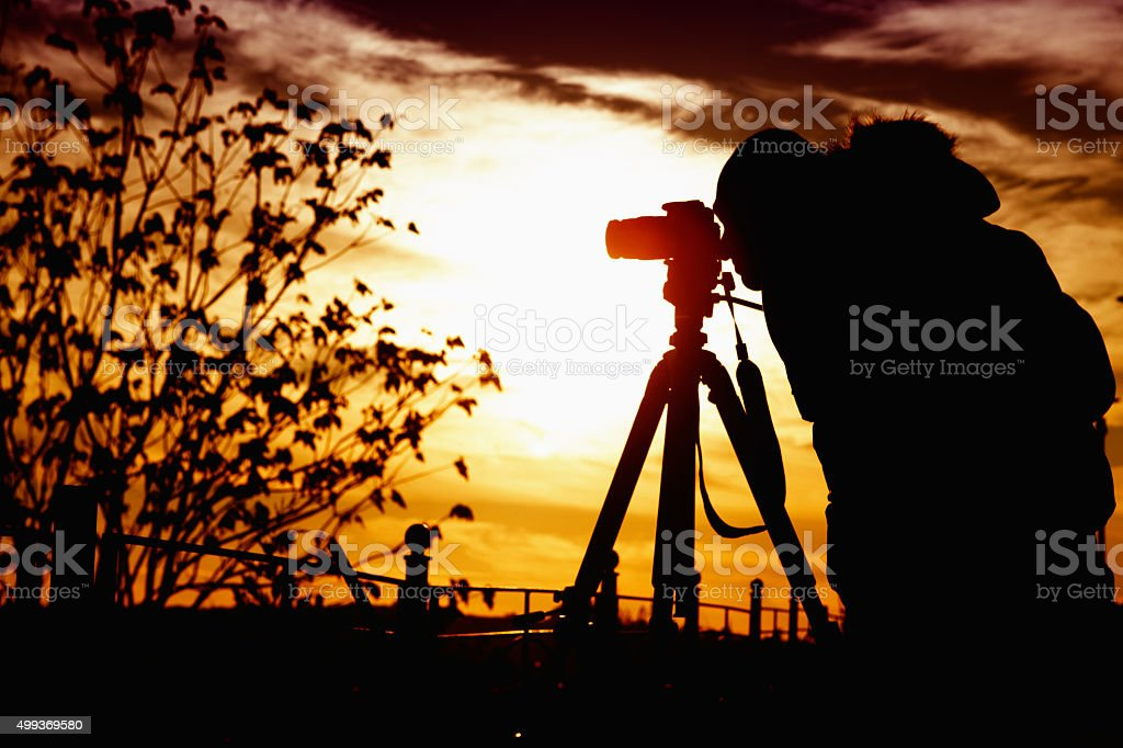 Man Photographing at Sunset stock photo