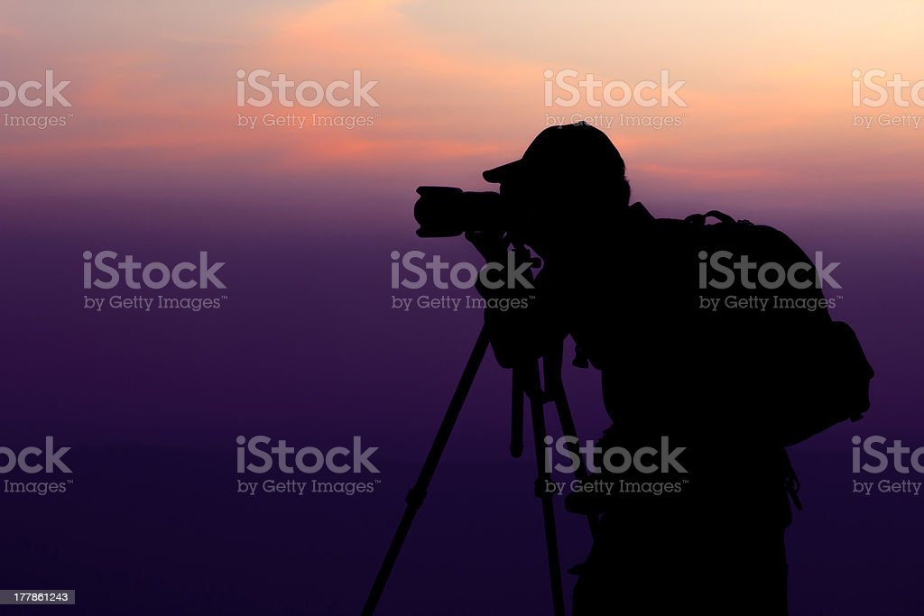 Man Photographing at Top of Mountain royalty-free stock photo