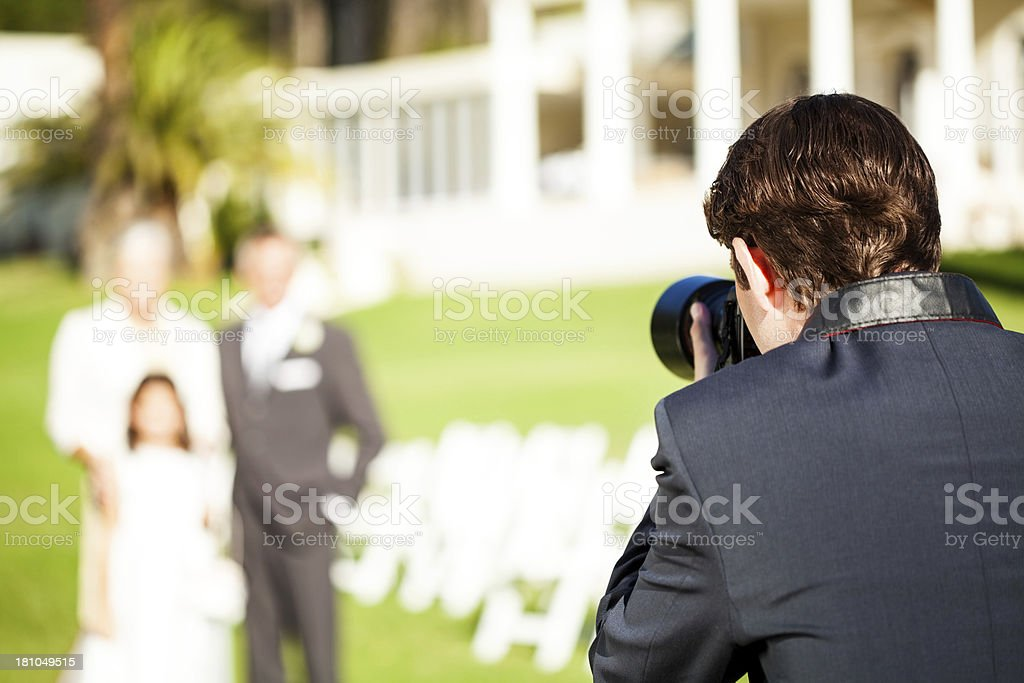 Man Photographing Family During Wedding royalty-free stock photo