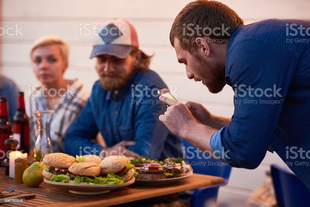 Man Photographing his Food stock photo