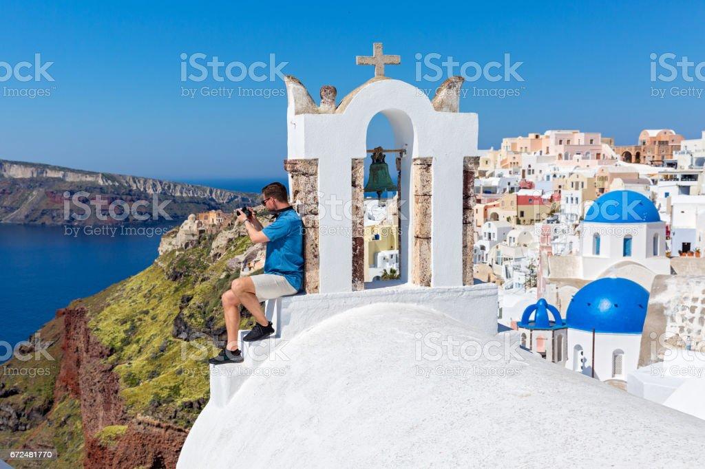Man photographing  landscape in Santorini stock photo