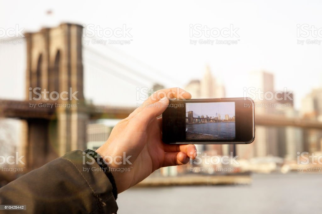 Man photographing New York City stock photo