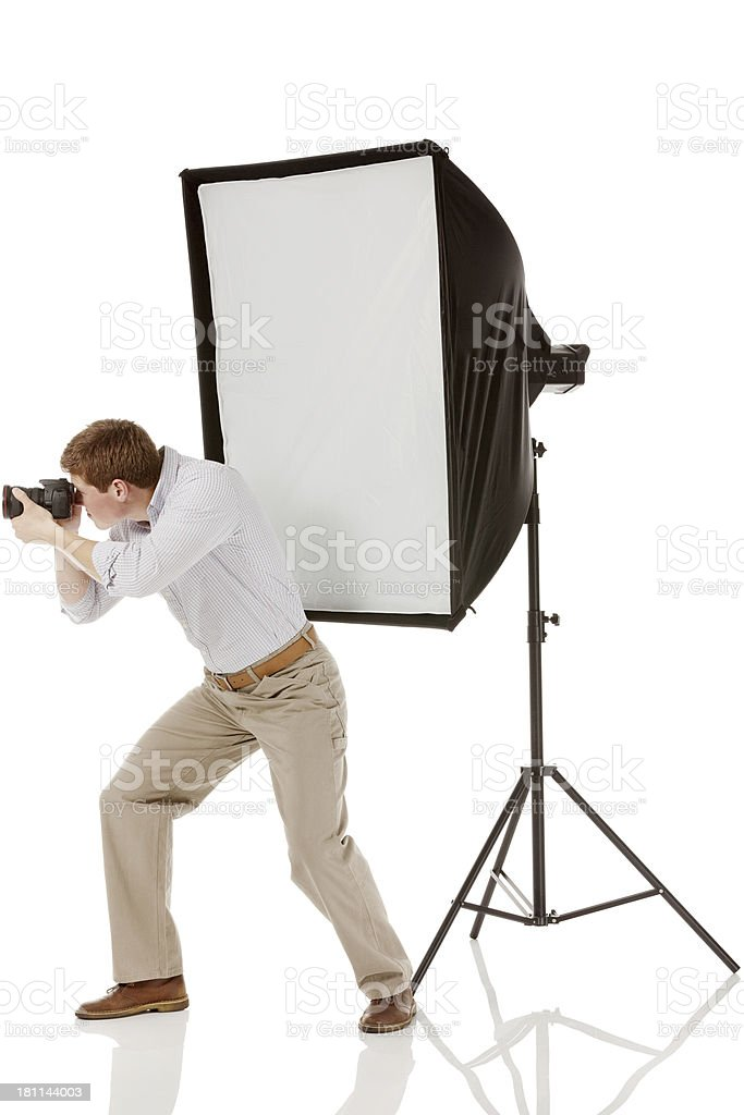 Man photographing with a digital camera royalty-free stock photo