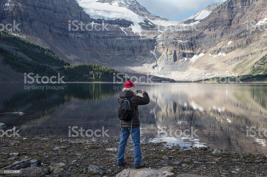 Man photographs Canadian Rockies stock photo