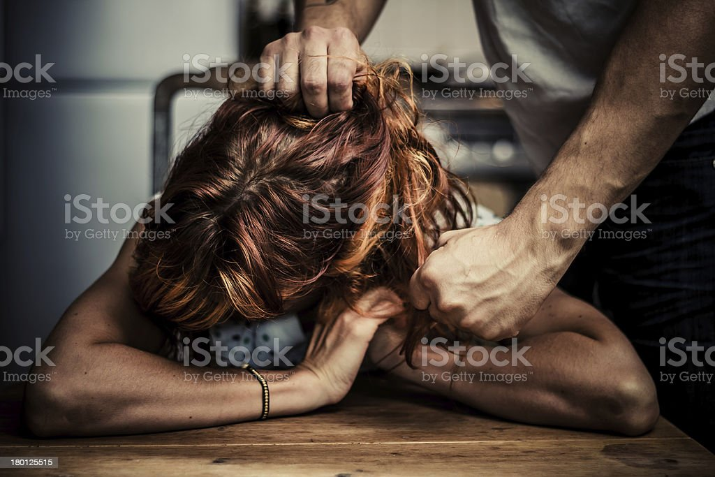 man physically abusing his girlfriend stock photo