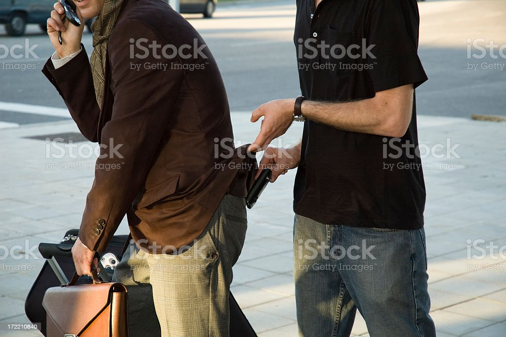 Man pick pocketing business man stock photo