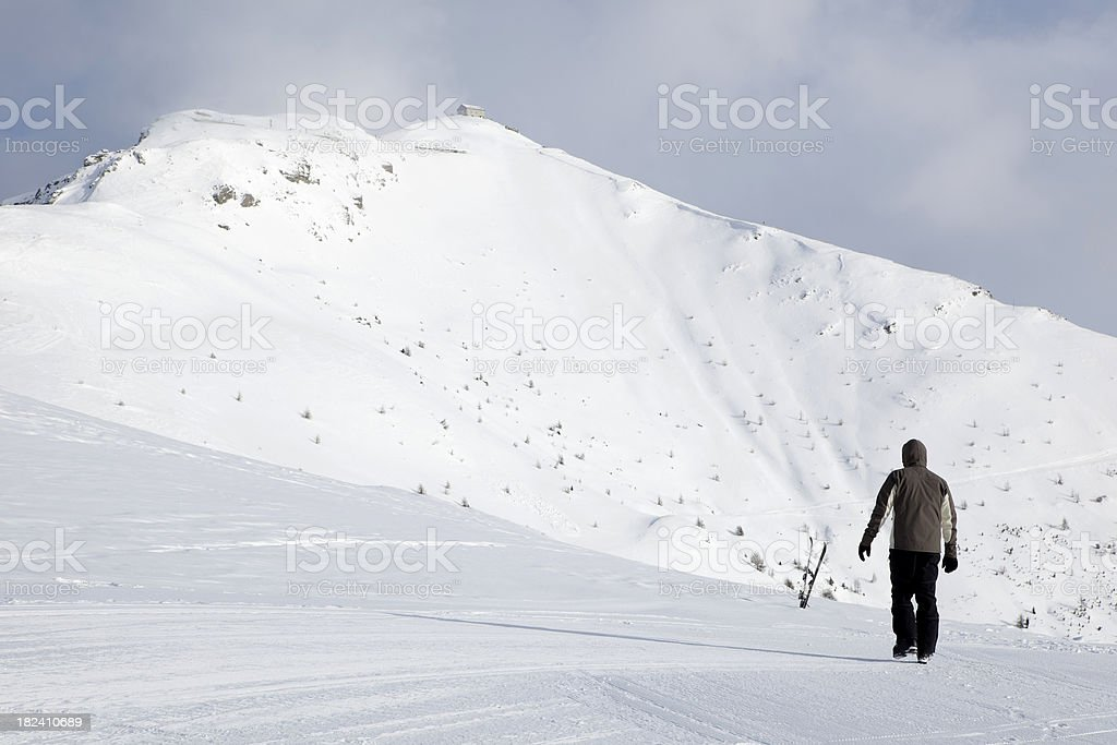 Man picking up ski for a tour in the mountains royalty-free stock photo