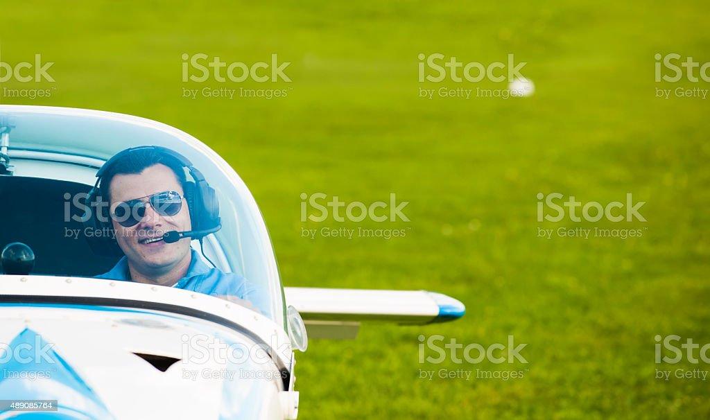 Man pilot looking at sky, preparing for flying stock photo