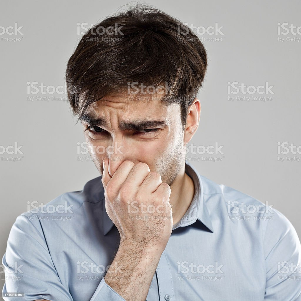 Man pinches nose stock photo