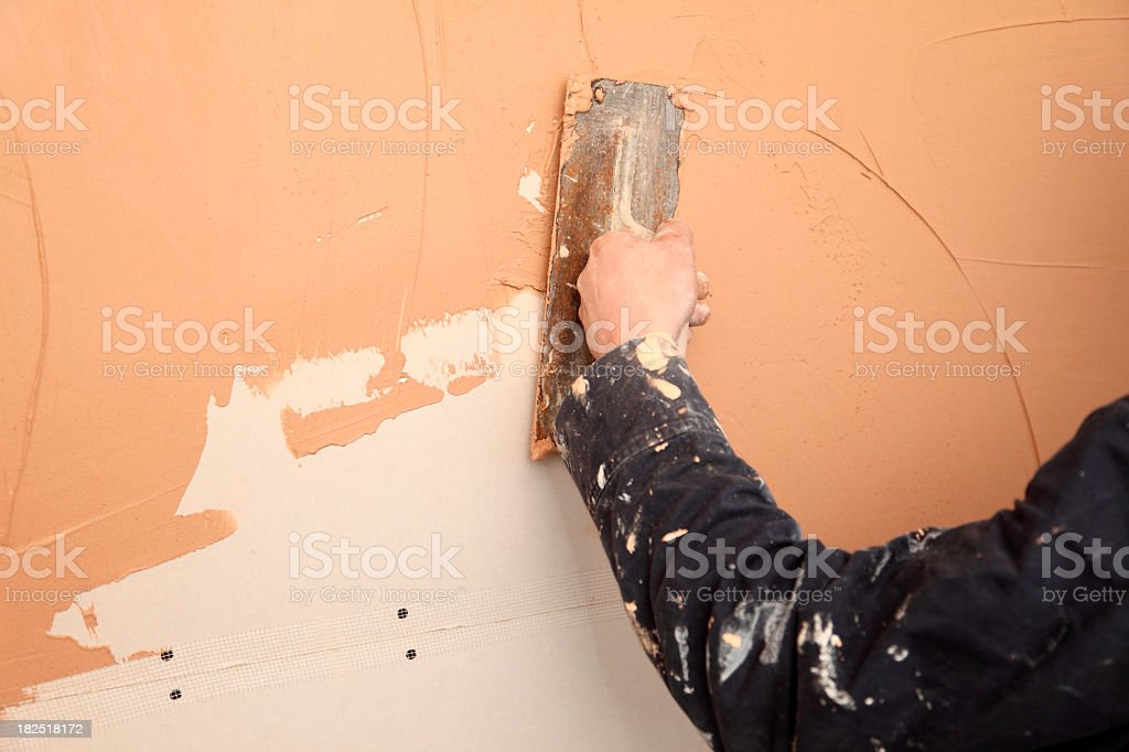 Man plastering a wall stock photo