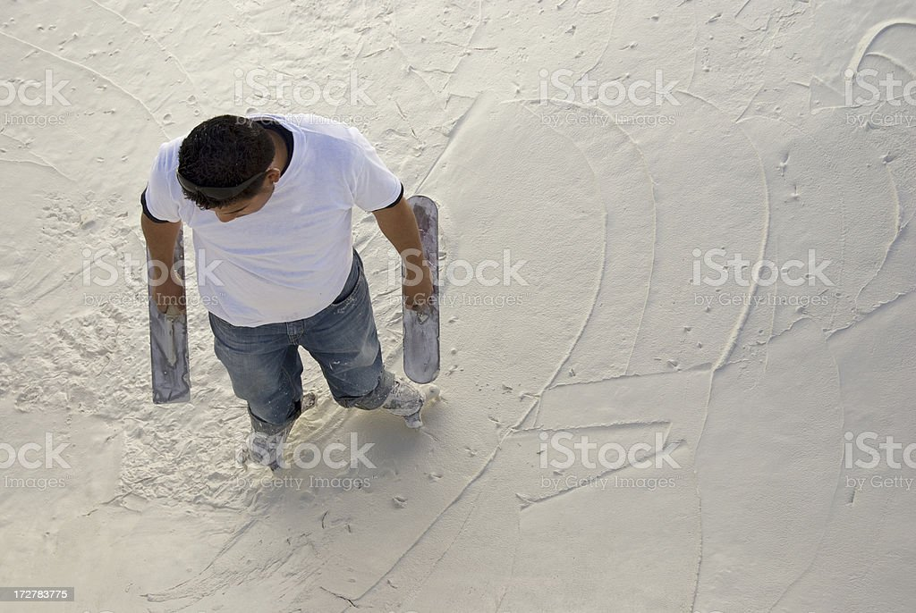 Man plastering the bottom of a pool stock photo