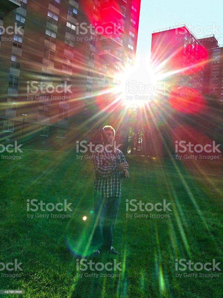 Man play baseball at the lawn royalty-free stock photo