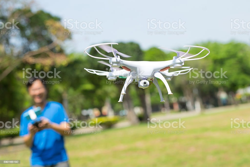 man play drone in park stock photo