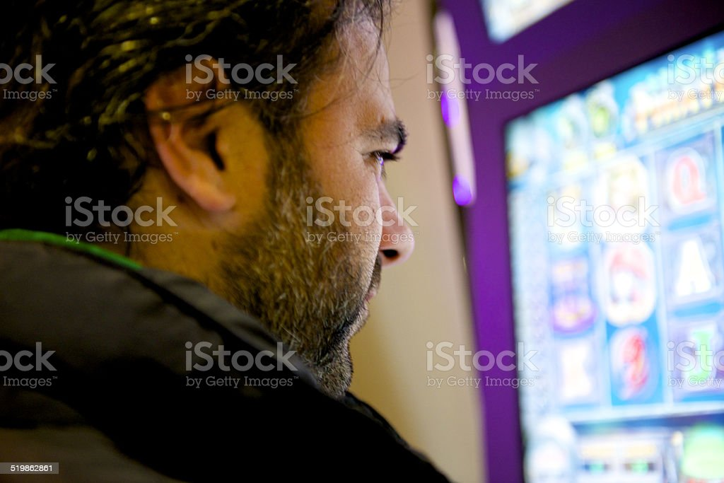 man play front to the slot stock photo