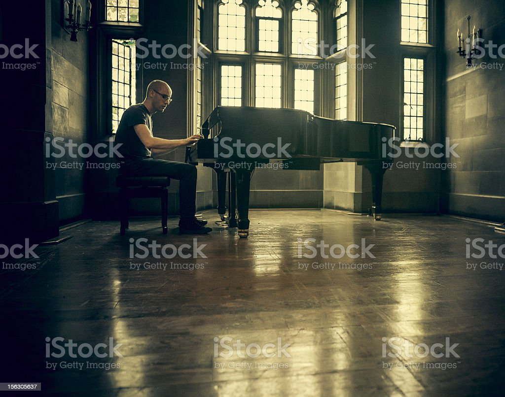 man playing a classic piano stock photo