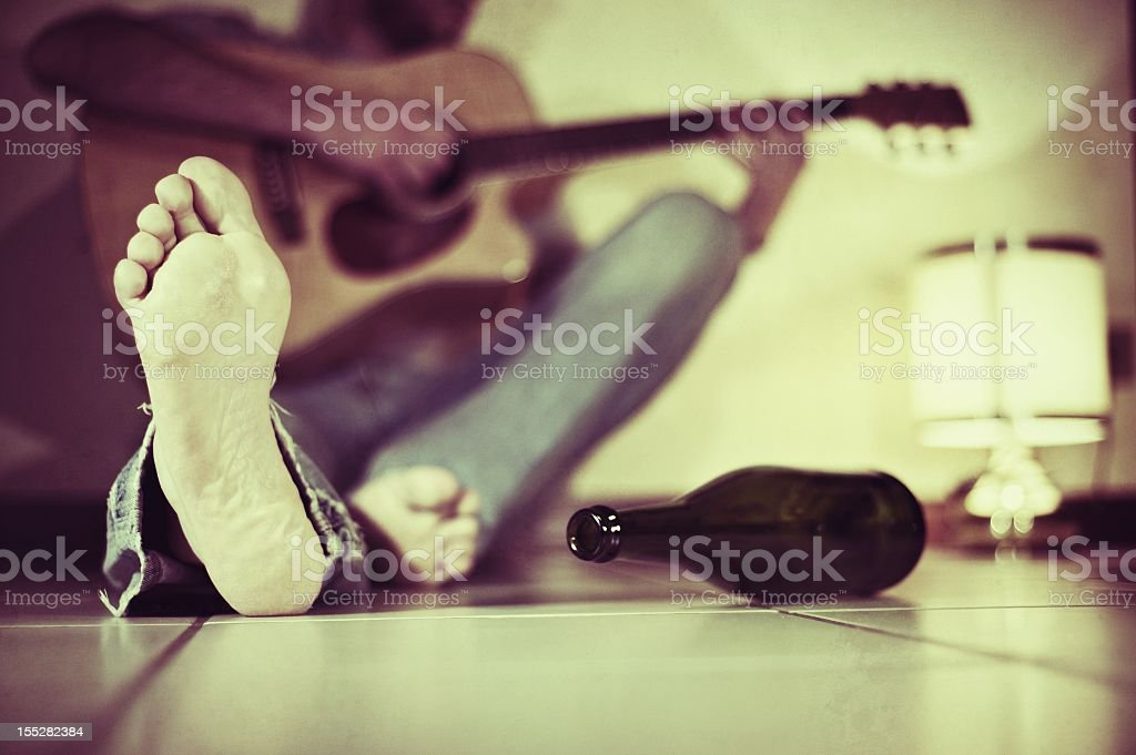 Man Playing A Guitar On The Floor royalty-free stock photo