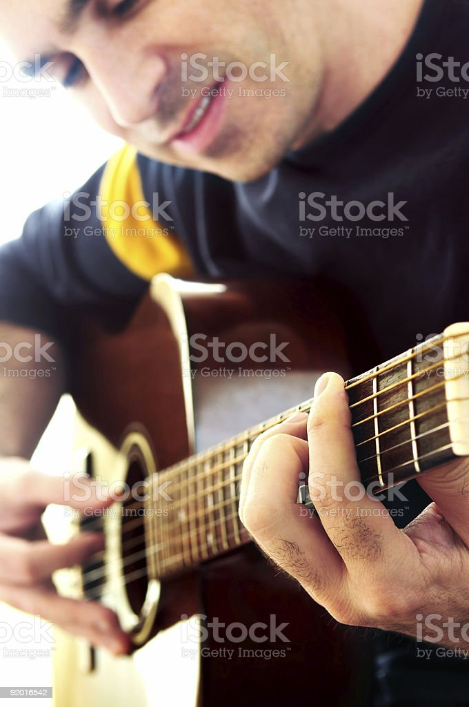 Man playing a guitar royalty-free stock photo