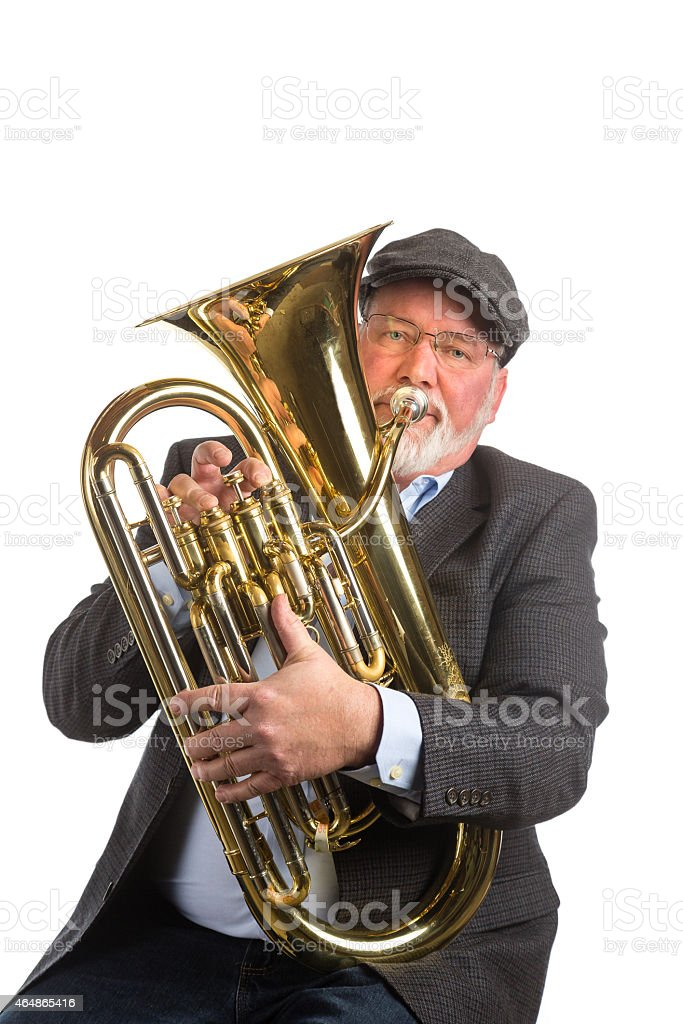 man playing a tuba stock photo