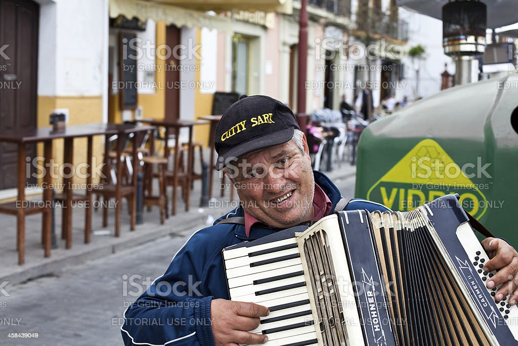 Man Playing Accordian in Seville, Spain royalty-free stock photo