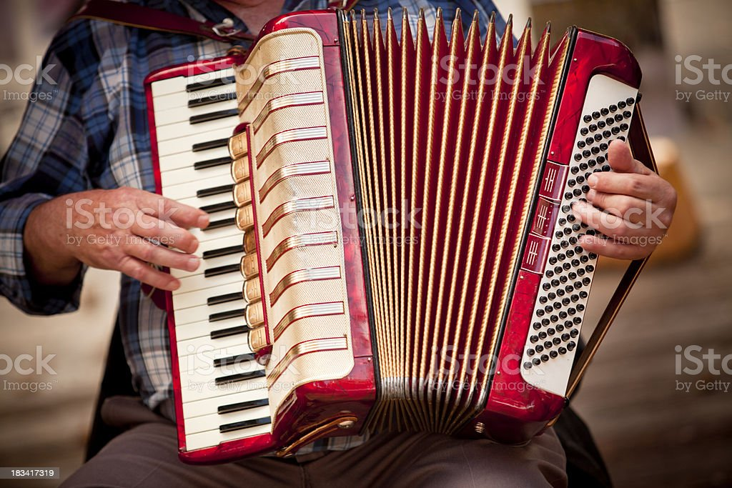 Man playing accordian stock photo