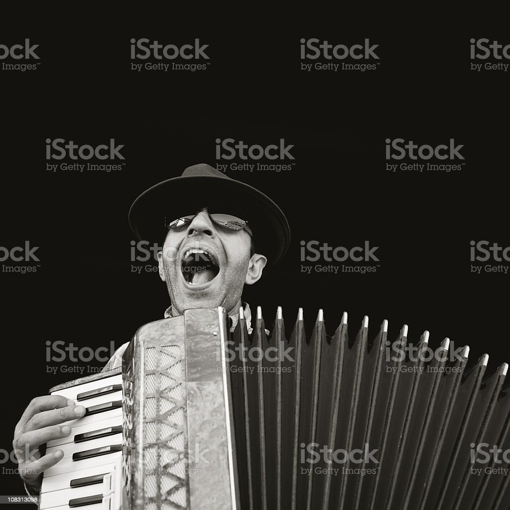 Man playing accordion stock photo