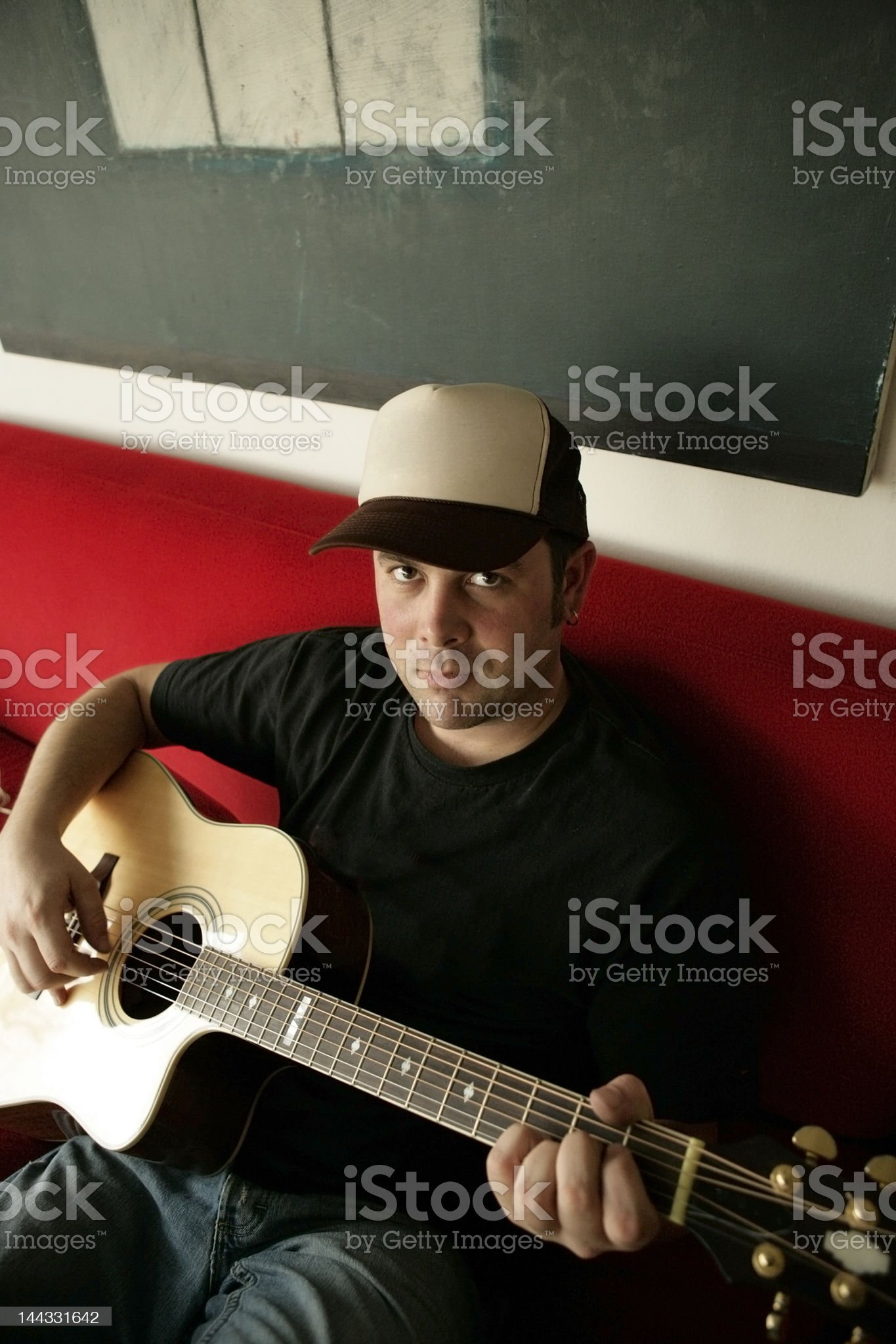 Man playing acoustic guitar royalty-free stock photo