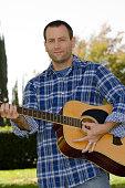 Man playing acoustic guitar.