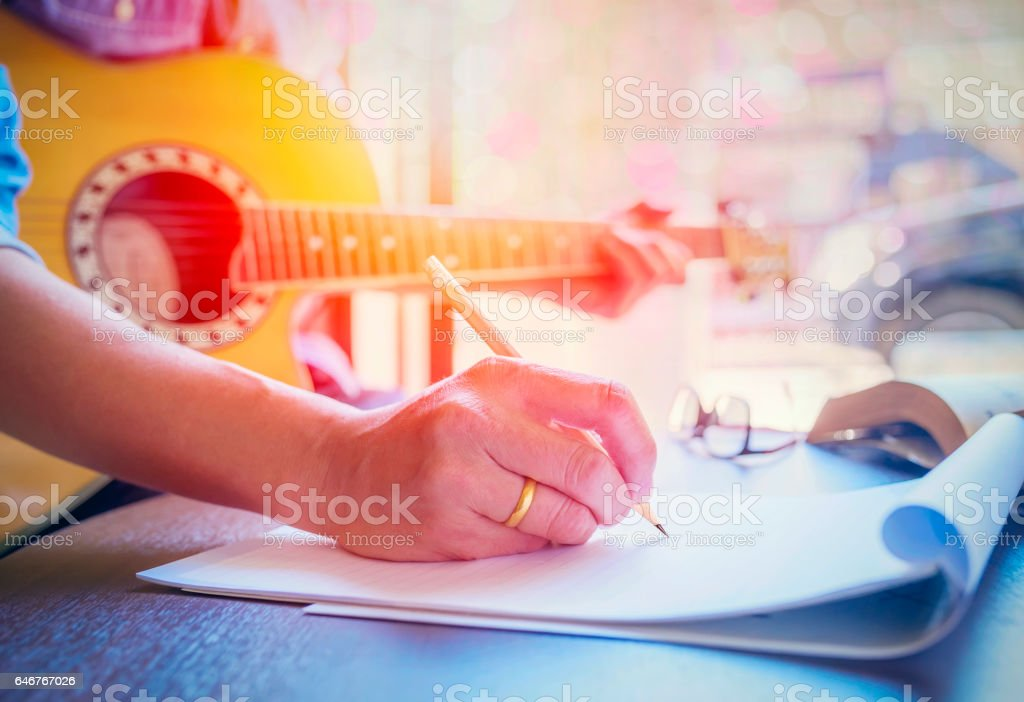 man playing acoustic guitar stock photo