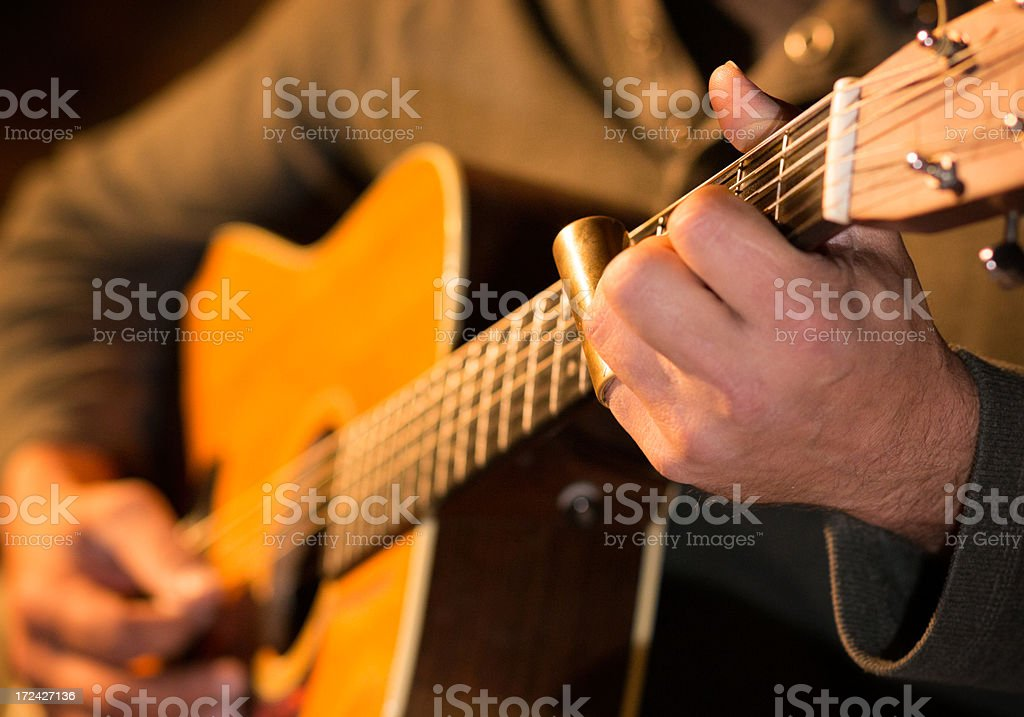 Man playing an acoustic guitar on stage royalty-free stock photo