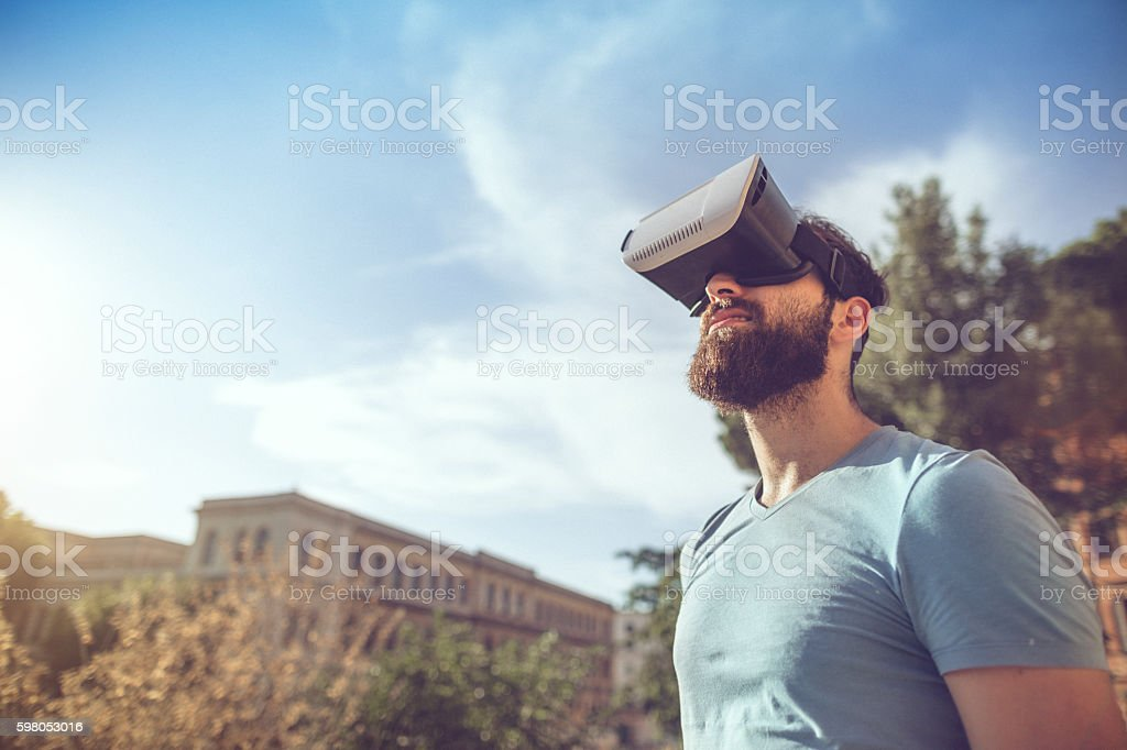 Man playing augmented reality with VR headset stock photo