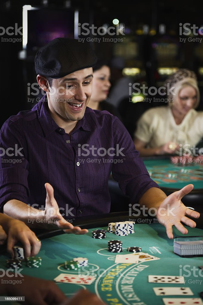 Man Playing Blackjack In a Casino royalty-free stock photo