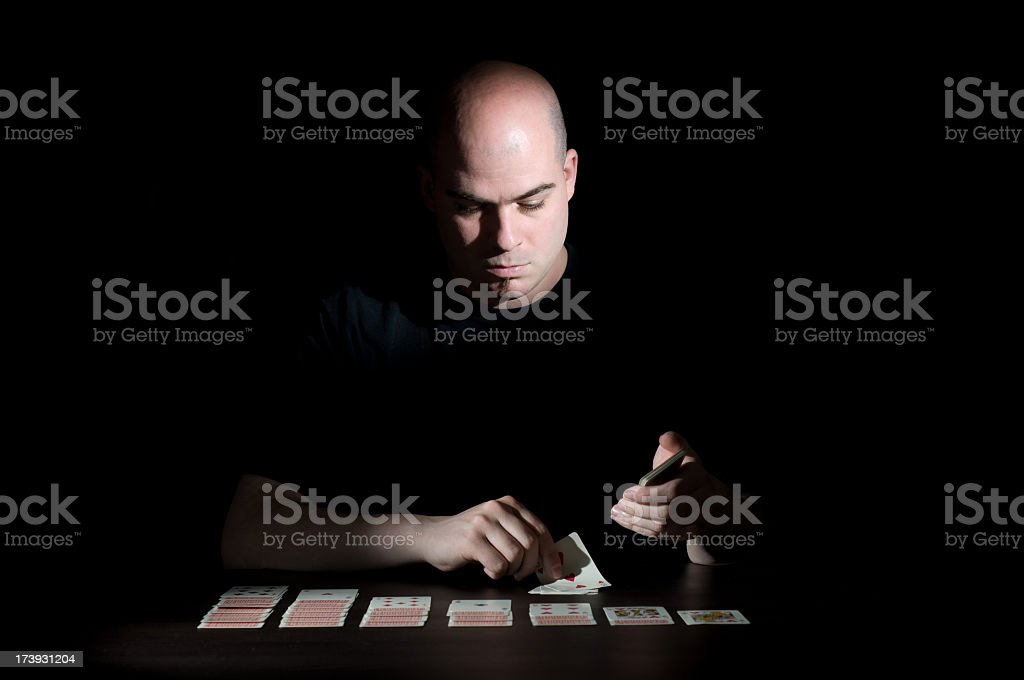 Man playing cards stock photo