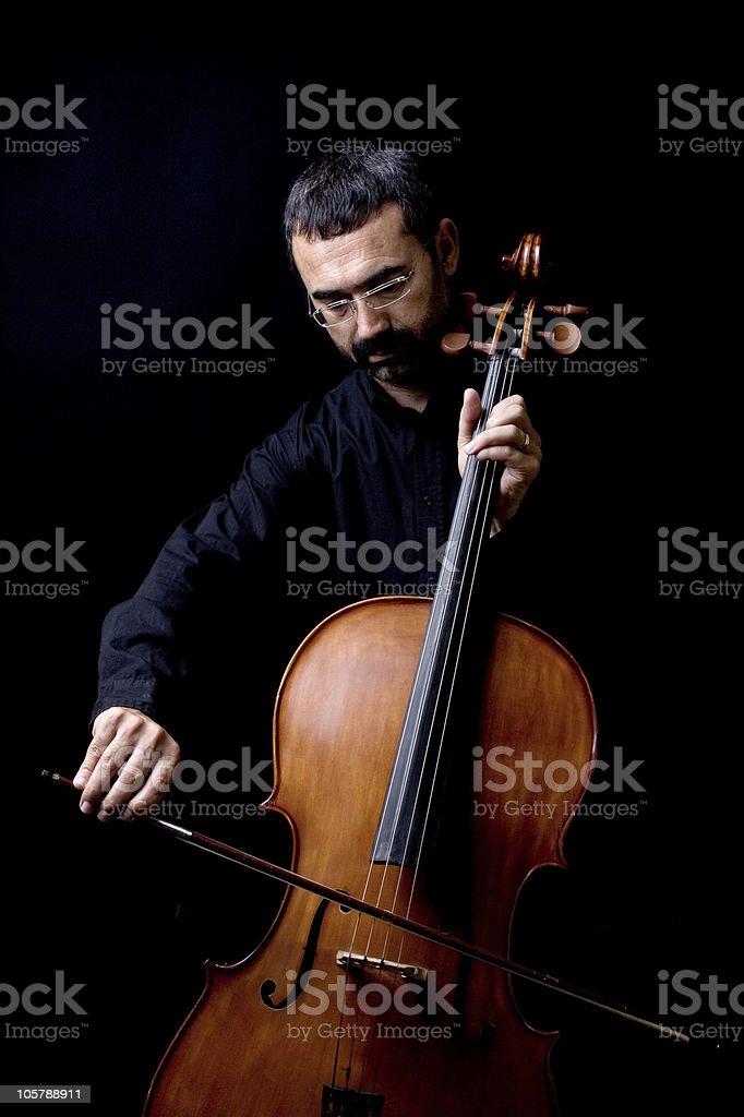 Man playing cello stock photo