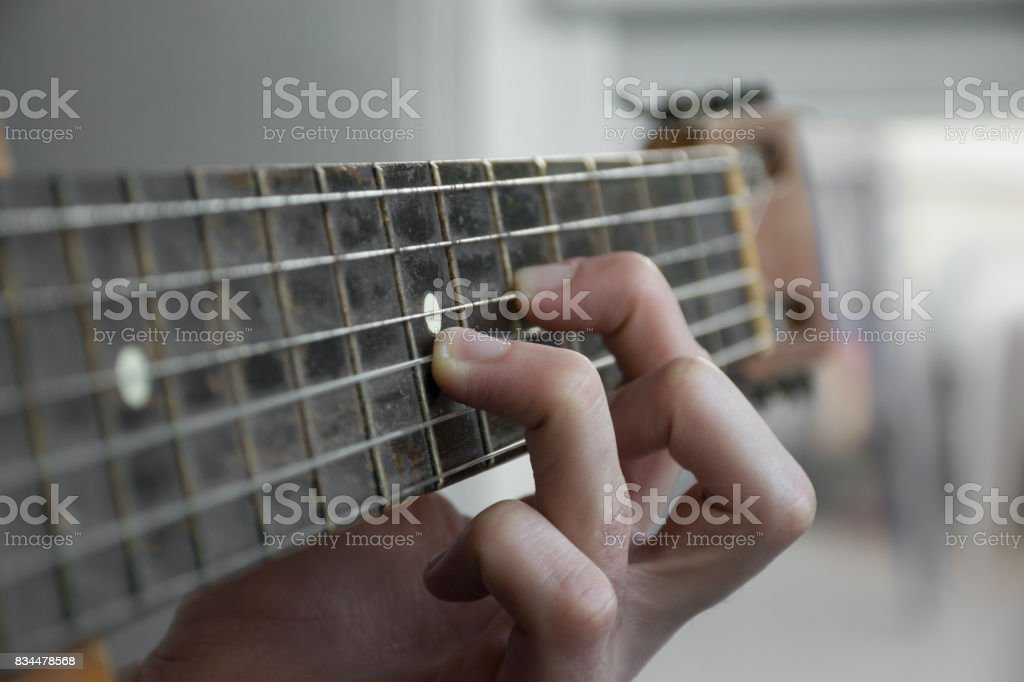 Man playing classic, acoustic guitar. Close up of guitarist hand playing acoustic guitar stock photo