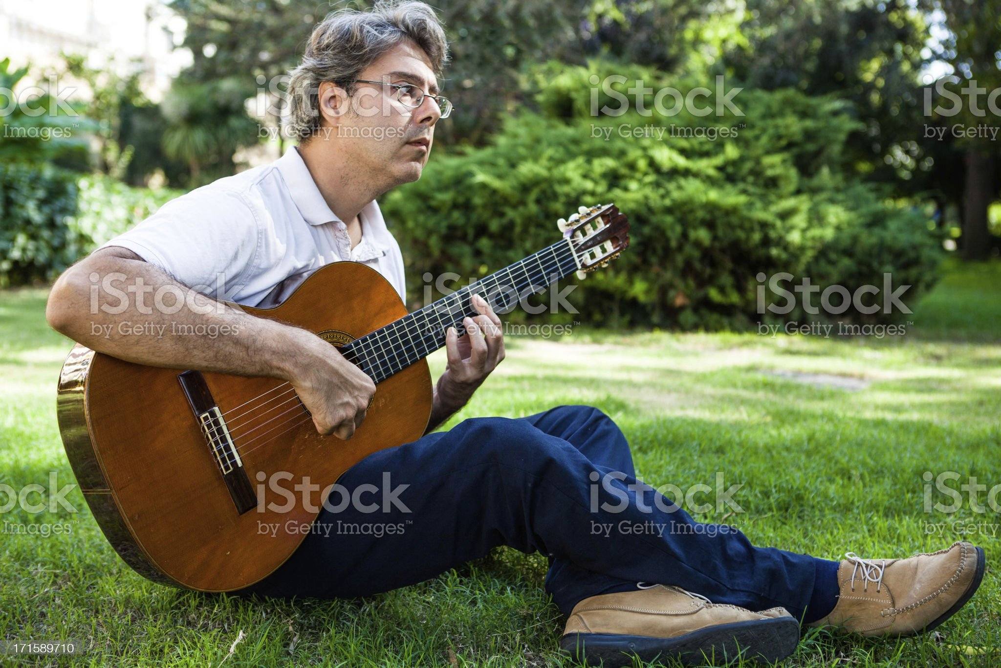 Man Playing Classic Guitar Outdoors royalty-free stock photo