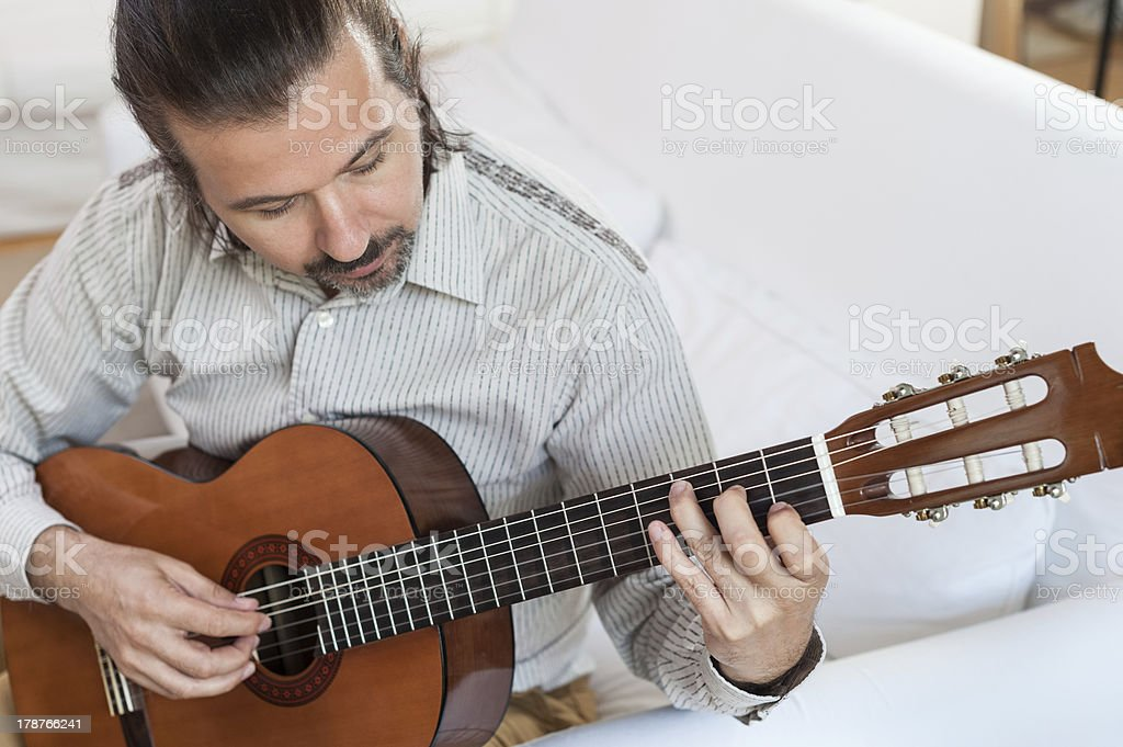 Man playing classical guitar royalty-free stock photo