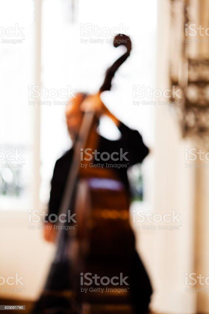 Man playing contrabass stock photo
