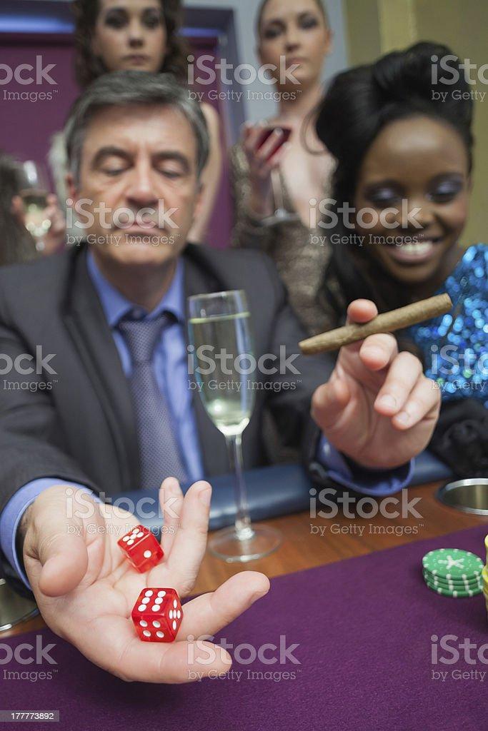 Man playing craps royalty-free stock photo