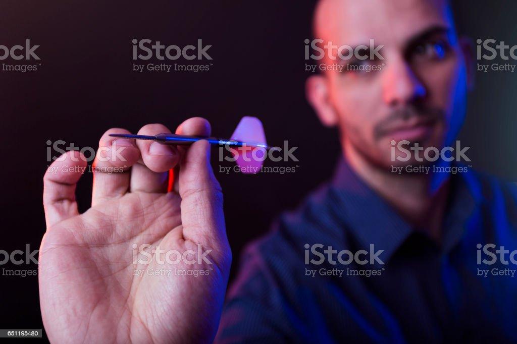 Man playing darts game stock photo