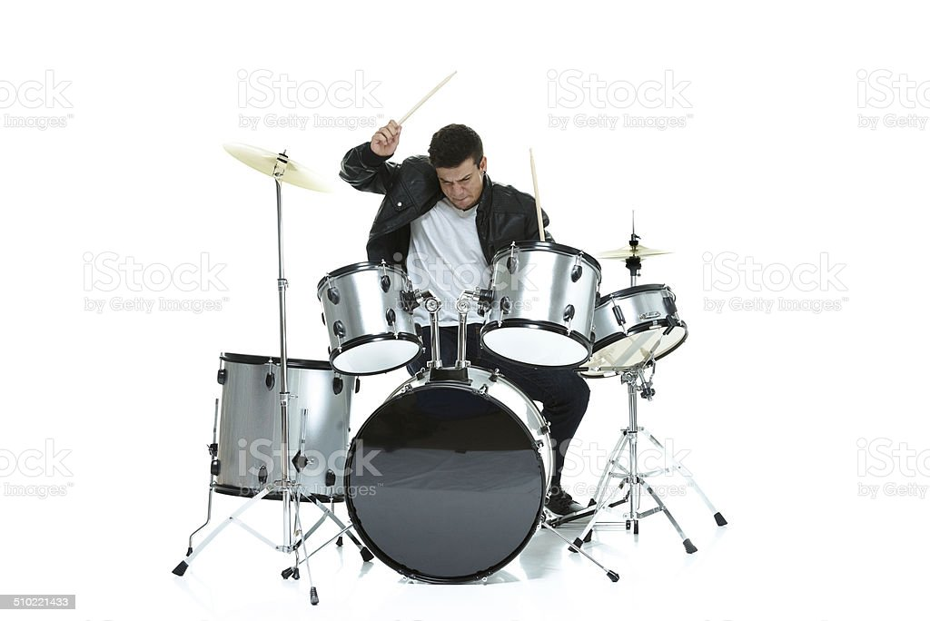 Man playing drums stock photo