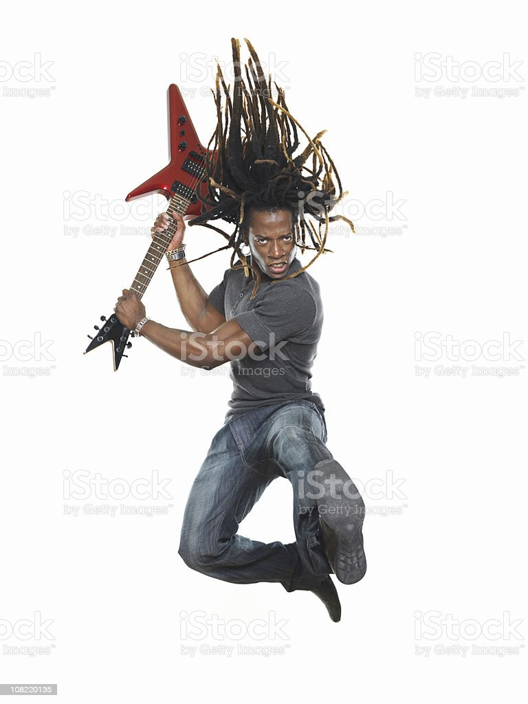 Man playing electric guitar and jumping royalty-free stock photo