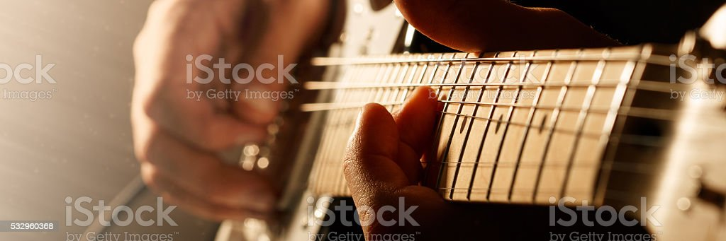 Man playing electric guitar stock photo