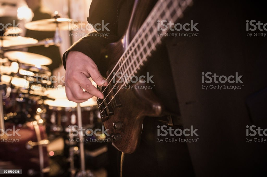 man playing electric guitar stock photo