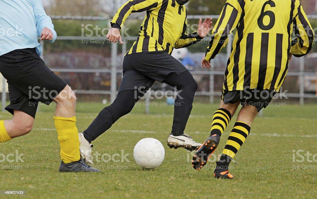 man playing football at real grass pitch royalty-free stock photo