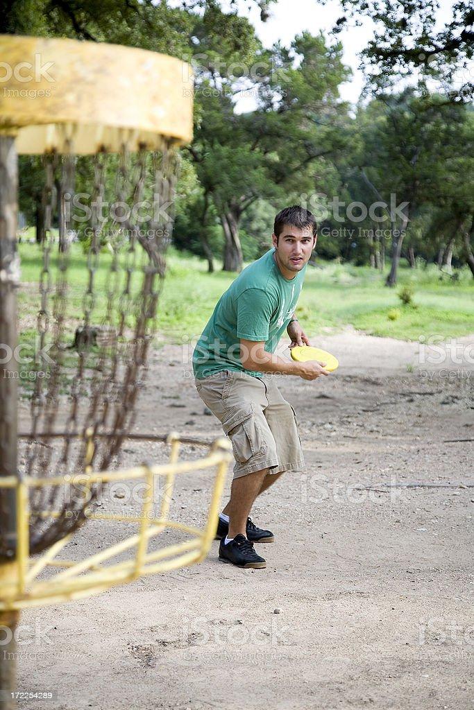 man playing frisbee golf stock photo
