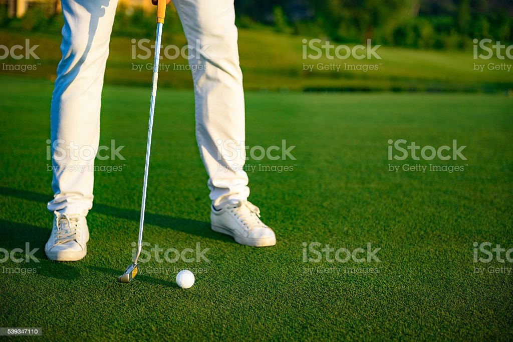 Man playing game of golf stock photo