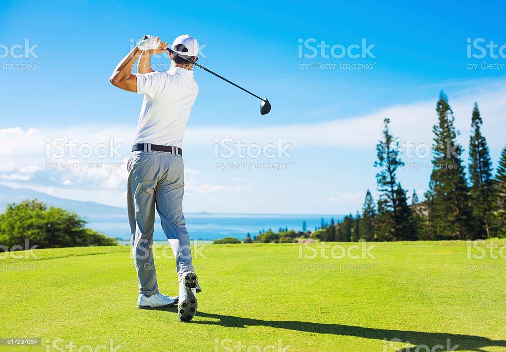Man Playing Golf, Hitting Ball from the Tee stock photo