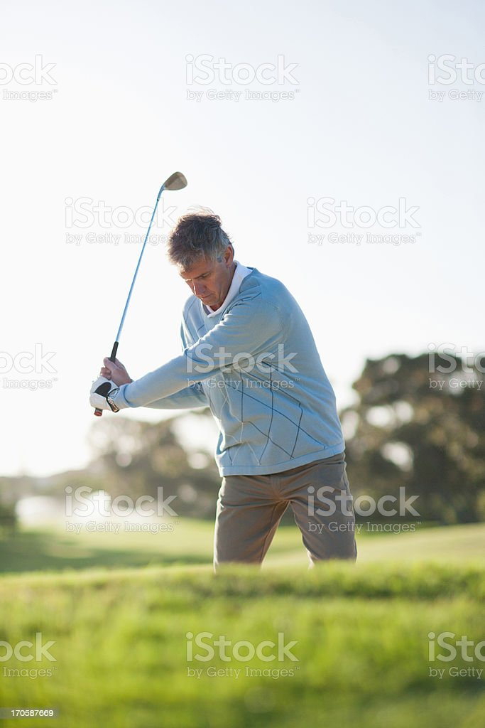 Man playing golf in sand trap royalty-free stock photo