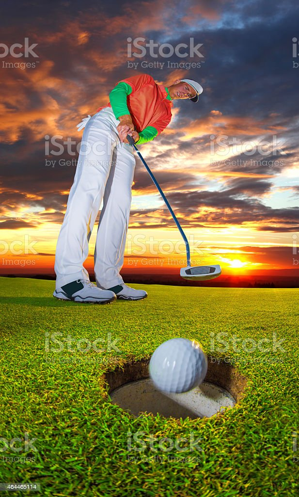 Man playing golfMan playing golf during a sunny day