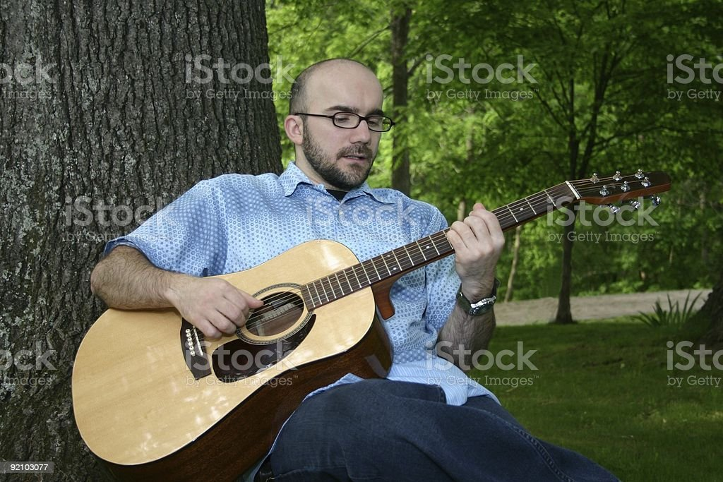 Man Playing Guitar Outside royalty-free stock photo